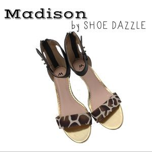 LIKE NEW Giraffe print gold and black wedge heel.
